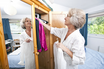 senior woman selecting dress